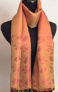 Silk scarf in burnt orange and red bamboo tree pattern